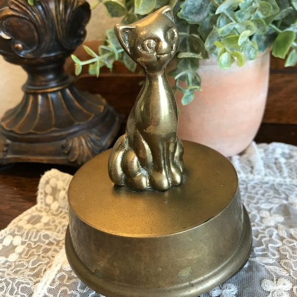 vintage rotating cat music box, plays Yesterday